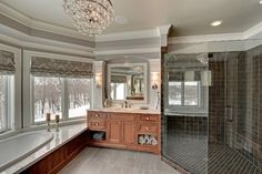 Bay windows with tub set. eliminate the vanity and put shower next to tub.