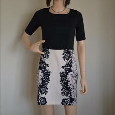 Med length beautiful LC dress Business casual black dress with cream pink/black floral bottom. The back scoops down and has a pretty sheer material that ties behind neck. LC Lauren Conrad Dresses Midi