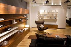 Modern furniture by BoConcept, love the hidden cabinets, especially for kids