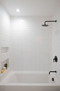 Bath Room Recessed Lighting Soaking Tub Full Shower Subway Tile Wall and Ceiling Lighting Each bathroom features matte black hardware and oversized Phylrich rain shower heads. Photo 11 of 107 in Best Bath Subway Tile Photos from Raber By VEIN White Subway Tile Bathroom, Subway Tile Showers, White Tiles, Bathroom Tile Walls, Bathroom Feature Wall Tile, Bathroom Niche, Bathroom Mirrors, Bathroom Cabinets, Bathroom Furniture