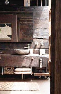 timber bathroom with stone basin