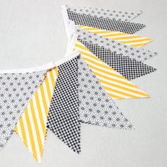 Adorable scandinavian bunting double sided made of gray, black and yellow cotton fabrics. Fabric would add the perfect finishing touch to your babys nursery, childs room or playroom. It makes also an excellent decoration for wedding. A reusable decoration for birthday parties. Great baby shower decor. An adorable photography prop. This sweet fabric bunting has 10 flags in 100% cotton, sewn on to gray bias tape. Each one is double sided so the bunting can hung anywhere in the room and l...