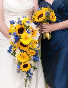 A Vows, Estes Park Original - Yellow Sunflowers, Black Eyed Susans, Gerbera Daisies, Blue Delphinium and White Roses