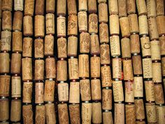 Cork curtain: it would be way more fun making and expanding this than paying $100 for a commercial divider bamboo screen.