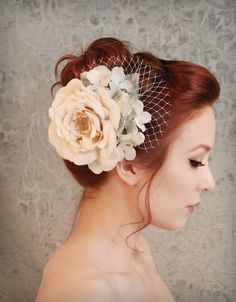 i don't think i wanna wear a veil...but i love the idea of a flower