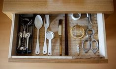 Utensils lie in a kitchen drawer in the home of minimalist Saeko Kushibiki in Fujisawa, south of Tokyo. #minimalism