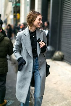 Grey coat and blue jeans