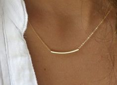 single delicate necklace minus the frizzy hair