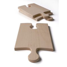 These Puzzle Piece Cutting Boards can be used in more ways than one. Each board can be used on its' own as a cutting board or a serving plate, or put some boards together and you have super-sized your workspace. It's ideal for cutting those long baguettes! But the best thing is that any wineglass can be fitted into the blank spot of a board. Using the boards at parties allows guests to enjoy both wine & delicacies, while still having one hand free to greet other friends. $26, Sold per piece.