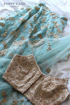 Gorgeous mint blue gold crop top lehenga set by Poppy Lane. Indian Gowns Dresses, Indian Fashion Dresses, Dress Indian Style, Indian Designer Outfits, Pakistani Dresses, Fashion Outfits, Lehnga Dress, Lehenga Blouse, Lehenga Choli