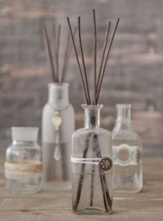 Give an old bottle new life with these homemade reed diffusers. Decorate with ribbon, rub-ons, buttons, ephemera, and fabric for a unique look that's all your own. | GreenCraft Magazine