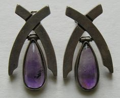 Antonio Pineda Amethyst 970 Silver Earrings These strikingly modern vintage Antonio Pineda earrings feature a large  teardrop shaped amethyst stone.  The earrings measure just over 1 1/4 inches by 3/4 of an inch and are marked Antonio Pineda, 970, Taxco and 58.
