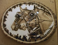 horse woodburning on basswood again white chalk, this ones too big for my scanner, and my camera doesnt do very good unless its ouside so ill try and get a better pic tomorrow and put it in my scra...