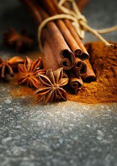 Cinnamon sticks ground cinnamon and anice selective focus by anjelagr