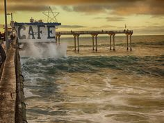 Big Surf and the iconic Pier Cafe. (thunderstorm clouds water ). Photo by photoandy