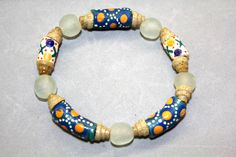 This stretch cord bracelet includes all recycled glass beads made in Ghana, West Africa: blue and white painted beads, cone spacers and white round translucent beads. All proceeds go to help build the computer lab at SDA School in Ankaase. Size: medium (7 1/4 inch around.) $20