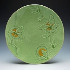 Kristen Kieffer Large plate Green flora.  Kieffer uses a variety of surfact design techniques including mishima.