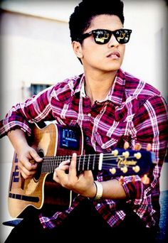Bruno Mars is easy on the ears and easy on the eyes :)