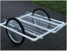 Instructables slide show of a bicycle trailer made out of PVC pipe and wire rack material. PVC Bike trailer