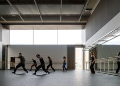 Concrete-clad dance studio designed to reference Brutalism.