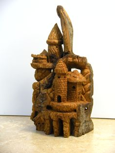"Mini-castle in cottonwood bark, about 6"" tall."