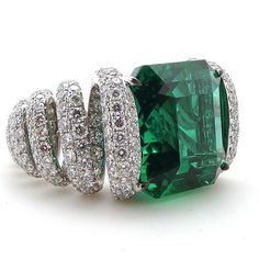 Not sure if it's a ring or pendant, but it's a 10.50ct Colombian Emerald and 490 Diamonds!!!