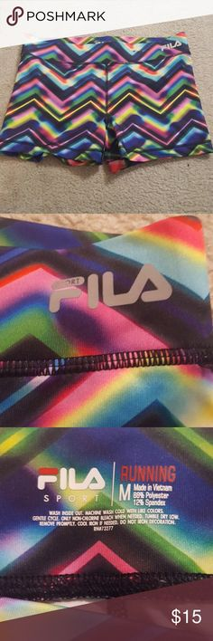 Fila running shorts Super cute only worn a few times! Thick waistband so they don't ride down when exercising Fila Shorts
