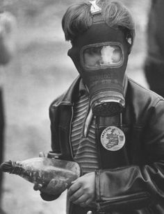 A boy with petrol bomb during street fighting in Londonderry. 1969. Clive Limpkin (www.clivelimpkin.com)