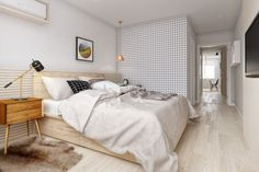 Bright and cozy apartment for a young couple with furniture in the style of mid-century, a variety of geometric patterns , using the wooden slats in the decoration , slate- magnetic wall and Scandinavian design .