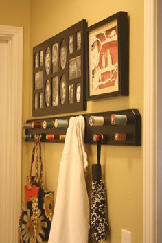 Coat rack made with 1x6, trim. And old wooden spools of thread.