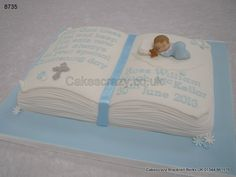 Open book style christening cake in blue with modelled baby and teddy, verse and decorated with delicate flowers http://www.cakescrazy.co.uk/details/christening-open-book-cake-blue-8735.html