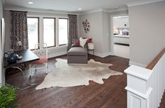 Good example of color palette.  Interesting window style with wood trimmed in white.  Also like the wood floor tone.