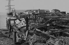 THEN: Ruins from the Seattle fire of July 26, 1879, looking west on Yesler's Wharf from the waterfront. (Courtesy Museum of History & Industry) Western Washington, Seattle Washington, Washington State, Tsunami, San Francisco Earthquake, Louisiana Purchase, National Weather, The Great Fire, Seattle Times
