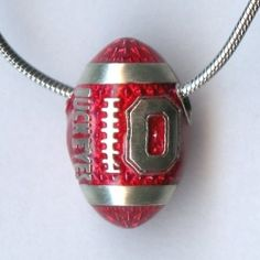 Sterling silver football pendant. Go Bucks! Available at Argo & Lehne Jewelers.