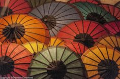 Sun umbrellas under the soft-light of the night market in Luang Prabang, Laos.