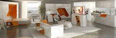 http://www.cosasdearquitectos.com/2010/10/muebles-minimalistas-boxetti/  Boxetti es una colección de muebles especialmente pensados para espacios reducidos. Con unas líneas minimalistas muy marcadas, se presentan como bloques compactos en resina blanca que según se van abriendo aportan un toque de color al espacio en el que se encuentran, ya que su interior naranja queda expuesto a la vista. Altavoces, televisión, camas, sofás o una cocina son algunas de las piezas de esta colección.