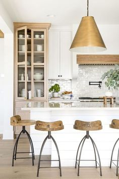 Beautiful white coastal farmhouse kitchen with gold and wood accents
