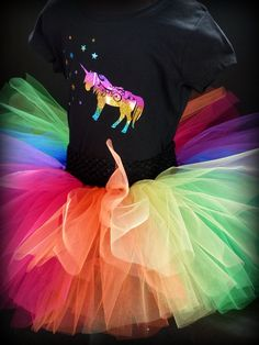Unicorn Tshirt or Onesie is a stunning option to be teamed up with the Mayhem Creations Rainbow tutu skirt!  The colours in this rainbow tshirt are very vibrant and look super special in real life.  The sparkle really compliments the fluffy tutu skirt and together they look amazing!  Check out the details over on our website and don't forget to add the tutu skirt to your tshirt order.