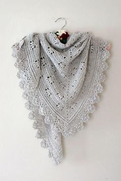 Who says crochet can't be all about luxury yarns too? This softer than soft baby alpaca is the perfect thing to snuggle into and the delicate puff design help this shawl harness the warmth with elegant good looks. Find this pattern at LoveCrochet.Com!