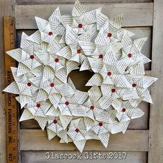 Rolled book page star flower ornament wreath. #glascockgifts #wreath #paperflowers #paper #paperart #wreath #bookpagewreath #wallart #handmade #handmadechristmas #christmaswreath #bibliophile