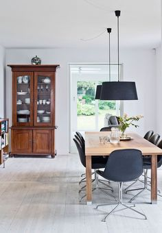 Simple and clean dining room with wooden and black furnitures.