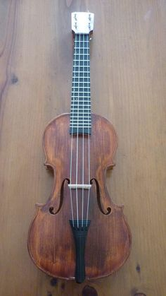 Ukulele neck /violin body. Great way to re-purpose an old violin.