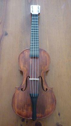 Look again: it's a Violele Violin Ukulele (ie. a ukulele with a violin body). Cool Ukulele, Ukelele, Cool Guitar, Banjo, Instruments, Music Love, Music Is Life, Musica Celestial, Ukulele Instrument