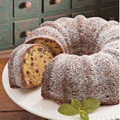 Chocolate Chip Cake. 1 box cake mix (yellow)  1 instant vanilla pudding mix packet  1 cup water  1 cup vegetable oil  4 eggs  1 bag miniature semisweet chocolate chips  Sprinkle with confectioners' sugar