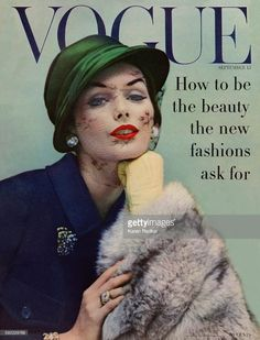 Model Lucinda Hollingsworth in green veiled hat, blue coat and fur muff