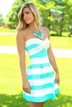 Make your Spring/Summer wardrobe pop with this strapless elastic teal and white party dress