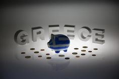 Greece must complete the first review of agreed reforms, including the governance of its financial sector, before European creditors can pump in more money to recapitalise Greek banks, the chairman of euro zone finance ministers said.