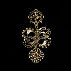 Enamelled gold openwork earring set with rubies; Italy, circa 1625