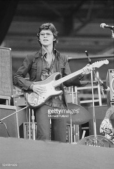 Canadian singersongwriter and guitarist Robbie Robertson performing with rock group The Band at Wembley Stadium London 14th September 1974 The Band...