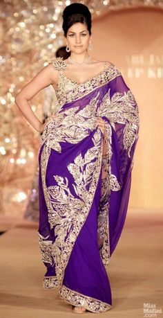 Purple sari. Abu Jani and Sandeep Khosla presents The Golden Peacock Collection.